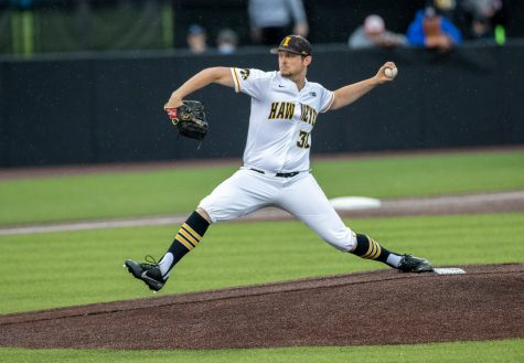 Iowa starting pitcher Trenton Wallace throws a pitch in the rain during a baseball game between Iowa and Illinois on Friday, May 14, 2021 at Duane Banks Field. The senior made his final start at Duane Banks Field, pitching six innings and allowing one run to cross the plate. The Hawkeyes defeated the Fighting Illini 4-2.