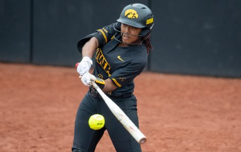 Iowa right fielder Nia Carter connects with a ball for a hit during a softball game between Iowa and Illinois on Saturday, May 15, 2021, at Pearl Field. The Hawkeyes defeated the Fighting Illini 7-2.