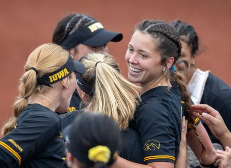 Iowa pitcher Lauren Shaw is congratulated by teammates after winning a softball game between Iowa and Illinois on Saturday, May 15, 2021, at Pearl Field. The Hawkeyes defeated the Fighting Illini 7-2.