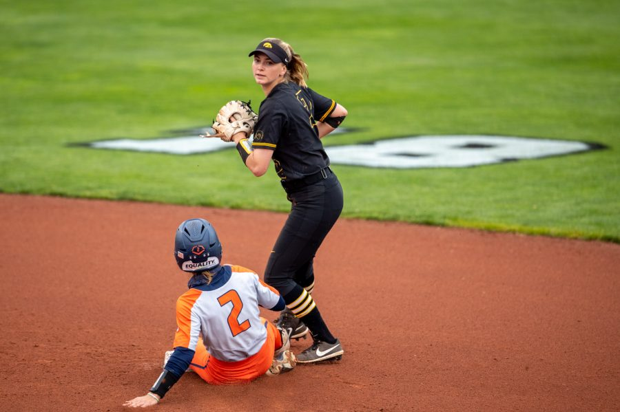 Iowa second baseman Aralee Bogar looks to throw to first after taking the force out at second during a softball game between Iowa and Illinois on Saturday, May 15, 2021, at Pearl Field. The Fighting Illini defeated the Hawkeyes 9-1 in game two of the Saturday doubleheader.