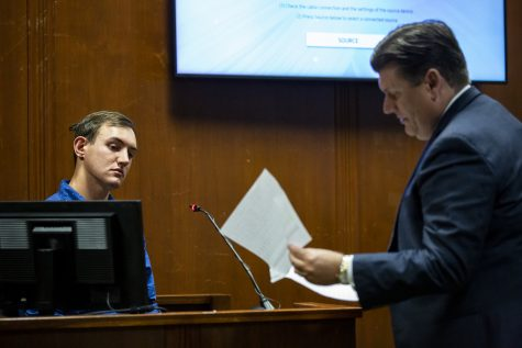 Defense attorney Chad Frese hands Dalton Jack, Mollie Tibbetts boyfriend, a phone record to review, while testifing for a second time, during Bahena Rivera