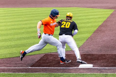 Iowa infielder Izaya Fullard catches the ball for an out at first base during the Iowa Baseball game against Illinois on May 15, 2021 at Duane Banks Field. Illinois defeated Iowa 14-1.