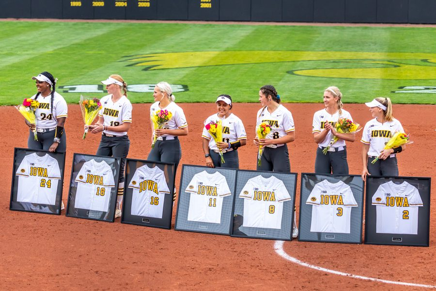 From left to right, Iowa seniors DoniRae Mayhew, Ashley Hamilton, Sarah Lehman, Avery Guy, Lauren Shaw, Allison Doocy, and Aralee Bogar stand with their framed jerseys during the senior ceremony after the Iowa Softball senior game against Illinois on May 16, 2021 at Bob Pearl Field. Iowa defeated Illinois 4-3.