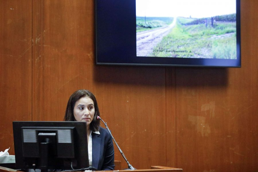 Former Iowa City police officer Pamela Romero testifies as an image of near where the body of Mollie Tibbetts was found is shown on a monitor during the trial of Cristhian Bahena Rivera at the Scott County Courthouse in Davenport, Iowa, on Thursday, May 20, 2021. Bahena Rivera is charged with first-degree murder in the death of Tibbetts.  (Jim Slosiarek/The Gazette)