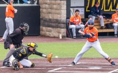 Iowa catcher Austin Martin catches the ball during the Iowa Baseball game against Illinois on May 15, 2021 at Duane Banks Field. Illinois defeated Iowa 14-1.