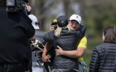 Iowa's Alex Schaake embraces family members after winning the Hawkeye Invitational at Finkbine Golf Course on Sunday, April 18, 2021. Iowa won the invitational 24 under par.