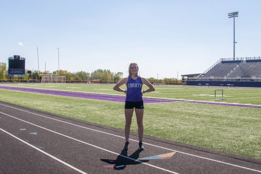 Ashlyn Keeney, a junior at North Liberty High School, poses for a portrait on the Liberty track. Keeney has both state-championship and state-place-winning feats in both cross country and track and field. As a freshman, she earned 1st place in both the 1500 and 3000 at Iowa's 2019 state track and field meet. She was set to build on this momentum the following year, but lost her sophomore season to COVID-19. Now she is setting her sights on a successful return while remaining team-oriented.