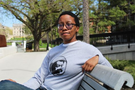 "Donika Kelly, an assistant professor of English at the University of Iowa, is seen outside of the English Philosophy Building on Friday, April 30, 2021. Kelly is also the author of an upcoming poetry collection, titled ""The Renunciations."""