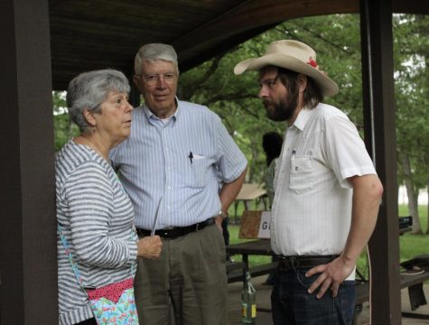 Johnson County residents Tom and Joan Cook speak to Johnson County Supervisor Candidate Jon Green at Green
