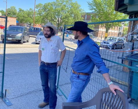 Johnson County Supervisor candidate Jon Green (left) speaks with Senate candidate Dave Muhlbauer (right) on the patio behind Georges Buffet in Iowa City. Photo courtesy of Adam Schantz, Muhlbauers campaign manager.