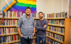 Grad student professors, (left to right) Aiden Bettine and Enrico Bruno pose for a portrait inside of the LGBTQ Iowa Archives at the Wesley Community Center on May 6 2021.