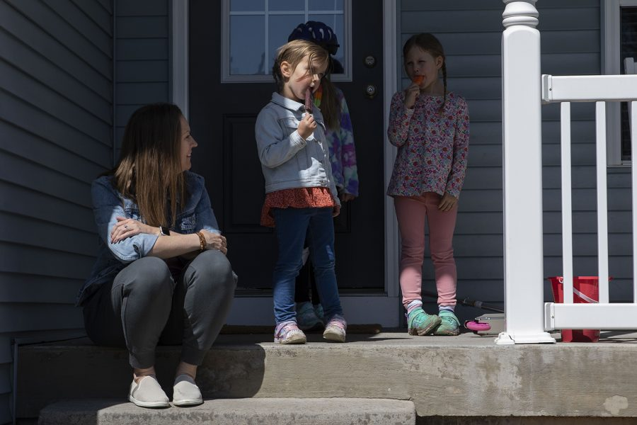"""Brooke Buxton talks with the kids in their family's bubble as they eat popsicles on Thursday, April 1, 2021. The Buxton's experienced a house fire in 2019 after their house was struck by lightning. They finished remodeling just as the pandemic began. """"We were getting our appliances delivered and I was sitting in there."""" Buxton said. """"We had no furniture or anything and I was sitting in the living room with nothing in there watching the Governor's speech about how there was going to be no school for the rest of the year and I just remember sitting there crying to myself."""""""