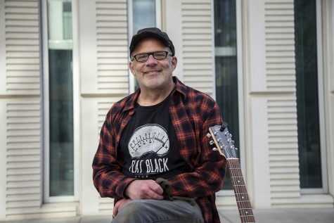 "University of Iowa College of Liberal Arts Strategic Communications Director and musician, Nic Arp, poses for a portrait outside of the Voxman Music Building at the University of Iowa on Tuesday, May 4, 2021. Arp produced an alternative folk album this year called ""The Crossing."""
