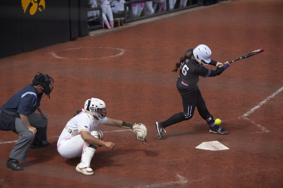Northwestern's Jordyn Rudd hits a foul ball during the softball game on Sunday, April 18th, 2021. Iowa defeated Northwestern 5-2.
