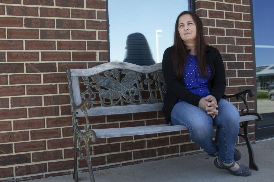 Kara Houser sits outside of her therapy office on May 5, 2021.