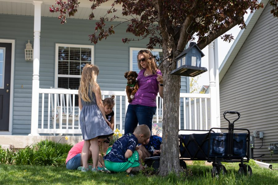 Brooke Buxton runs through a science lesson with the six children in their learning pod in the front yard on April 26, 2021. Buxton was a first grade teacher for 13 years before the pandemic, but chose to take the year off to help their three children go through online learning. She now teaches four other neighboring children as well.