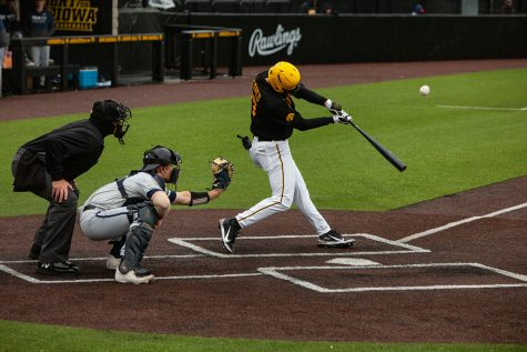 Iowa infielder Dylan Nedved hits the ball during a baseball game between Iowa and Penn State at Duane Banks Baseball Stadium on Saturday, May 8, 2021. The Nittany Lions defeated the Hawkeyes 5-4.