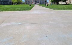 Residue of erased chalk messages left by the UI College Republicans are seen on Friday, May 7.