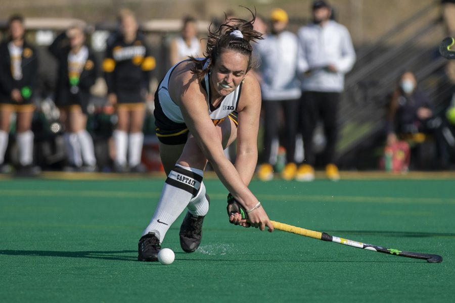 Iowa defender Anthe Nijziel sweeps the ball during the Big Ten field hockey tournament semifinals against No. 1 Michigan on Thursday, April 22, 2021 at Grant Field. The Hawkeyes were defeated by the Wolverines, 0-2. Michigan will go on to play against No. 7 Ohio State in the championships on Saturday.