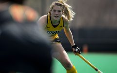 """Iowa midfielder Ellie Holley waits for the ball during a field hockey game against Maryland on Sunday, April 4, 2021. """"[We] kind of took it as an opportunity,"""" Holley said. """"We took the fall as yeah our season was canceled, but we had seven freshmen and in season it can be really hard to bond because you're just so busy. And having the four or five months to actually get to know the freshmen, going into a spring season we're such a unit now that it's, we're not, you know, wasting time with the 'Oh, hi. Where'd you like the ball? What's your name?' Like we all know each other so well. I think that's really helped us flourish."""""""