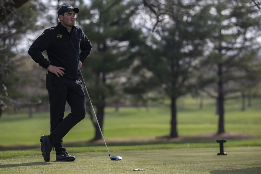 Iowas Mac McClear watches other players on the green during the mens golf Hawkeye Invitational on Saturday, April 17, 2021 at Finkbine Golf Course.