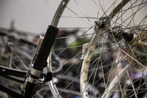 Bikes and spare parts sit in the back room at the new Bike Library Gilbert St. location in Iowa City on Monday, Feb. 22, 2021. Bike Library Inc. is a volunteer-run project in Iowa City that allows community members to check out and buy restored bicycles.