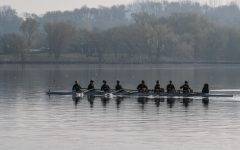 On the lake on Saturday, April 24, 2021. University of Iowa 2 Novice 8 rowing team gets an early warmup. The Hawkeyes won with a time of 7:14.50.