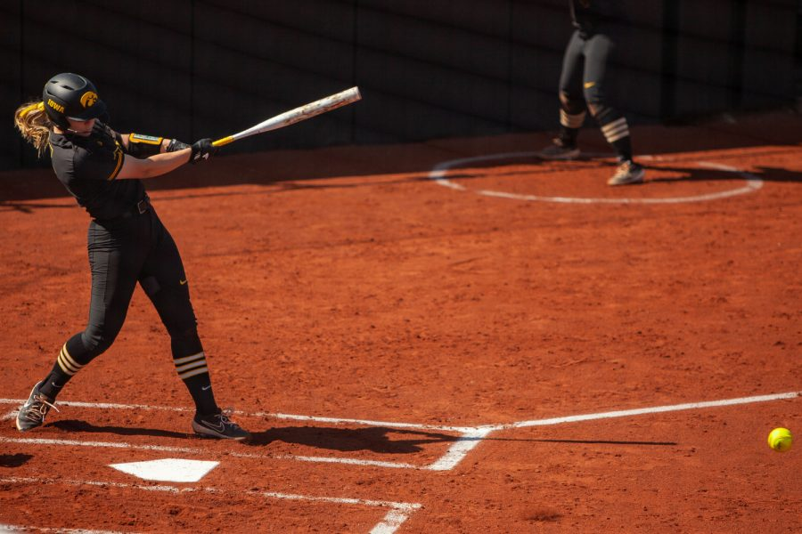 Iowa utility player Denali Loecker hits the ball during a softball game between Iowa and Northwestern at Bob Pearl Softball Field on Saturday, April 17, 2021. The Wildcats defeated the Hawkeyes 9-7.