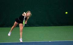 Iowa's Alexa Noel returns the ball during a women's tennis meet at the Hawkeye Tennis and Recreation Complex on Thursday, Feb. 26, 2021. The Hawkeyes defeated the Hoosiers with a score of 4-3.