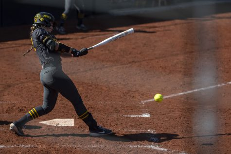 Iowa utility player Brylee Klosterman hits the ball during a softball game against Nebraska on Friday, May 7, 2021 at Pearl Field. The Hawkeyes defeated the Huskers, 1-0.