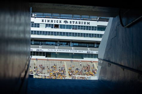Fans sit in Kinnick Stadium during a spring football practice  on Saturday, May 1, 2021.
