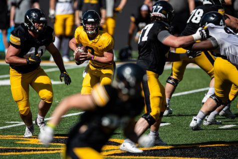 Iowa quarterback Alex Padilla looks to pass during a spring practice for Iowa football at Kinnick Stadium on Saturday, May 1, 2021.