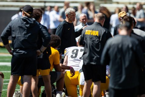 Iowa head coach Kirk Ferentz talks to players after a spring practice at Kinnick Stadium on Saturday, May 1, 2021.