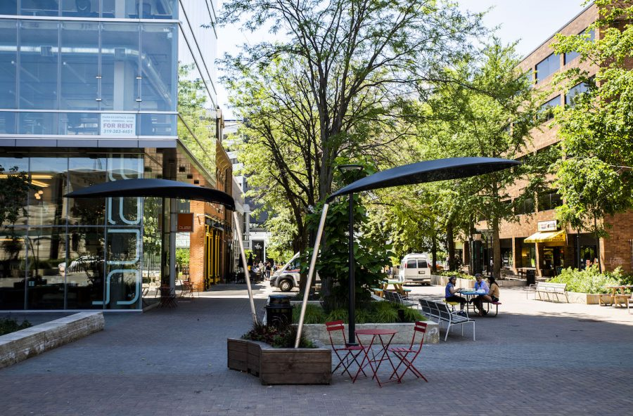 New shade structures at the pedestrian mall on Wednesday, June 16, 2021.The new shade structures are a collaboration between the Iowa City Downtown District, artist and architect Michael LeClare, Dan Kuenzi of City Construction Lacy Sexton of Sexton Design. (Jeff Sigmund/Daily Iowan)