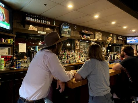 Jon Green stands at the bar with his girlfriend of three years, Eleanore Taft, as they wait for polls to close on Tuesday, June 8, 2021. Green won the special election for Johnson County Supervisor with 66.1 percent of the vote, according to the unofficial election night results.