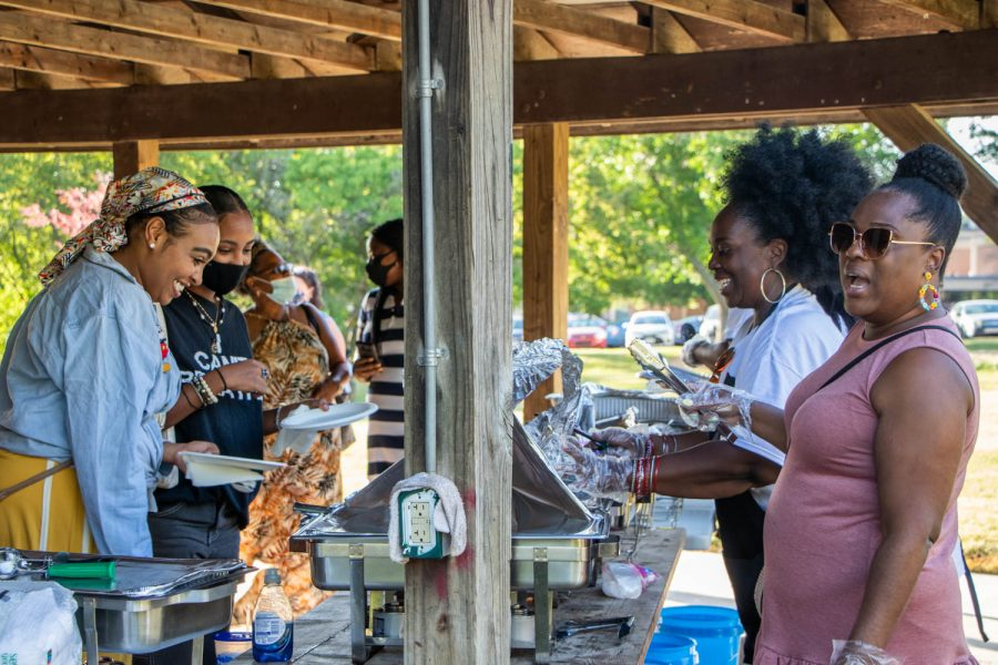 Attendees at a Juneteenth celebration hosted by Iowa Freedom Riders get their food on June 19, 2021.
