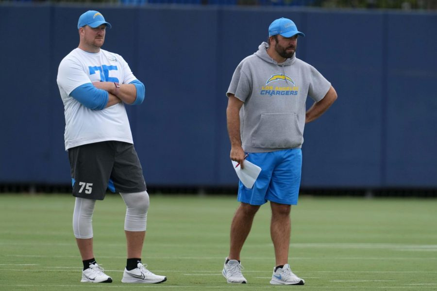 Jun 7, 2021; Costa Mesa, CA, USA; Los Angeles Chargers run game coordinator coach Frank Smith (right) and tackle Bryan Bulaga (75) during organized team activities at the Hoag Performance Center. Mandatory Credit: Kirby Lee-USA TODAY Sports