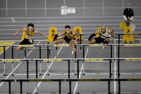 Iowa hurdlers Gratt Reed, Jamal Britt, Iowa alum Aaron Mallett––who ran unattached––compete in the 60m hurdle premier final during the second day of the Larry Wieczorek Invitational on Saturday, Jan. 23, 2021 at the University of Iowa Recreation Building. Reed, Britt, and Mallett finished fifth, second, and first, respectively. Due to coronavirus restrictions, the Hawkeyes could only host Big Ten teams. Iowa men took first, scoring 189, and women finished third with 104 among Minnesota, Wisconsin, Nebraska, and Illinois.