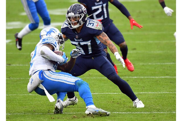 Dec 20, 2020; Nashville, Tennessee, USA; Tennessee Titans strong safety Amani Hooker (37) tackles Detroit Lions running back DAndre Swift (32) during the first half at Nissan Stadium. Mandatory Credit: Christopher Hanewinckel-USA TODAY Sports