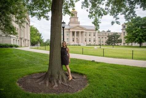 University of Iowa lecturer Kirsten E. Kumpf Baele poses next to a tree on Friday, June 18, 2021.