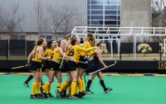 Hawkeyes celebrate their first point during a field hockey game between Iowa and Michigan at Grant Field on Saturday, March 15, 2021. The Hawkeyes defeated the Wolverines, 2-1, in a shootout.