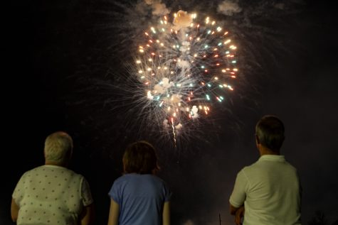 Spectators watch fireworks from a Hy-Vee parking lot in Coralville on Saturday, July 4, 2020.