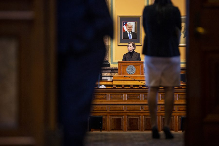 Gov. Kim Reynolds prepares for the State of the State Address within the house chambers of the Iowa State Capitol Building on Tuesday, Jan. 12, 2021 in Des Moines. Tuesday marks the second day of the 2021 Iowa legislative session, in which Gov. Reynolds will give her address in the evening.