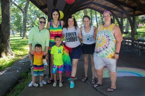 Amanda Green, Cole Green, Knox Green, Lisa Skriver, Danielle Barefoot, Chelsea Green, and Iowa City Queer Exchange admin Claire Czerwionka pose for a portrait at City Park in Iowa City during a Pride pool party on June 19, 2021.