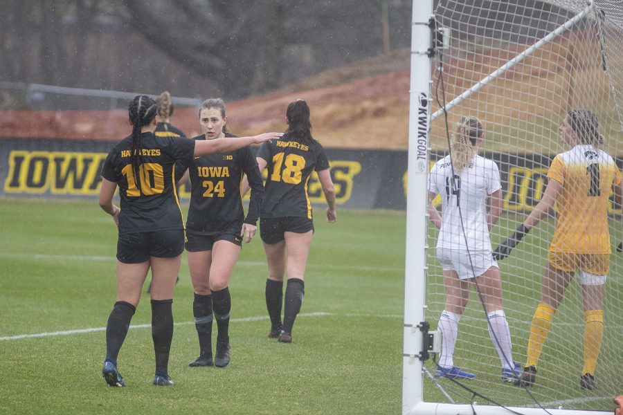 Iowa teammates talk to each other before a corner kick during the Iowa women's soccer match v. Penn State at the Iowa Soccer Complex on Thursday, March 25, 2021. The Nittany Lions defeated the Hawkeyes 1-0.