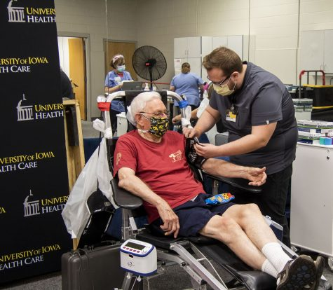 Ken Royar of Iowa City waits while Neil LeFebure BSN starts preparations for Royar to donate blood. A blood drive was held for Tyler Juhl who is battling cancer. The drive was held by University of Iowa DeGowin Blood Center. while Friday, June, 25, 2021.