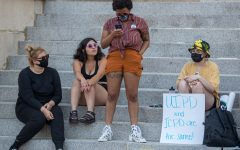 Members of the Cops off Campus organization speak to the crowd during a protest on the Pentacrest in Iowa City on Sunday, July 4, 2021.