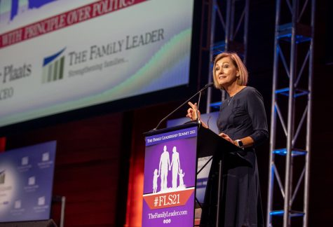 Iowa Gov. Kim Reynolds delivers a speech during The Family Leadership Summit in Des Moines, Iowa, on Friday, July 16, 2021.  Members of the crowd cheered when Gov. Reynolds brought up legislation that banned mask mandates in public schools.