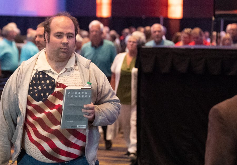 An event-goer walks out of the ballroom after  The Family Leadership Summit finished in Des Moines, Iowa, on Friday, July 16, 2021.