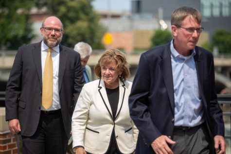 University of Iowa President Barbara Wilson walks on campus July 20.